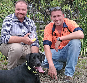 Our outreach officer Reece Pianta is shown the ropes with electric ant sniffer dog Eden and her handler.