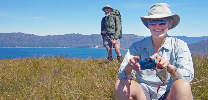 Remote area volunteers can spend up to three weeks tackling weeding out sea spurge along the coastline of Tasmania's Wilderness World Heritage Area.