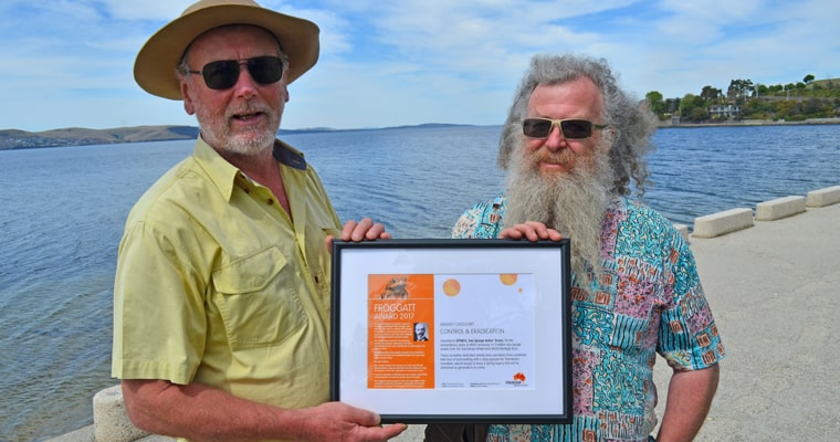 Jon Marsden-Smedley and Chris Arthur from Tasmania's Sea Spurge Action Teams receive their Froggatt Award at Lower Sandy Bay, Tasmania, 2017. Photo: John Sampson