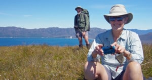 Remote area volunteers, including Andy McQueen and Liz McQueen, can spend up to three weeks tackling weeding out sea spurge along the coastline of Tasmania's Wilderness World Heritage Area.